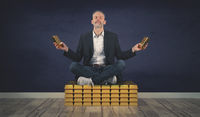Relaxed businessman sits on a stack of gold bars