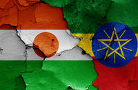 flags of Niger and Ethiopia painted on cracked wall