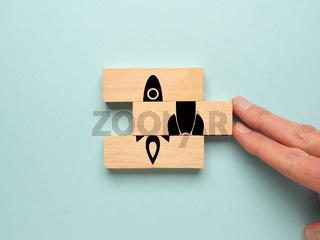 Start up concept with wooden blocks on a blue background
