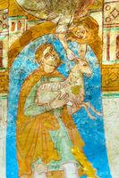 Abel sacrifices a lamb