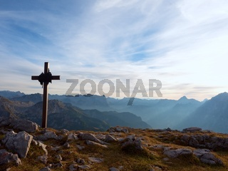 Iron cross at mountain top in alp. Monument to the dead climbers