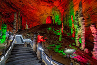 People sightseeing interior of magnificent  Huanglong Yellow Dragon Cave