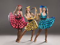Showgirls in pin-up dresses view
