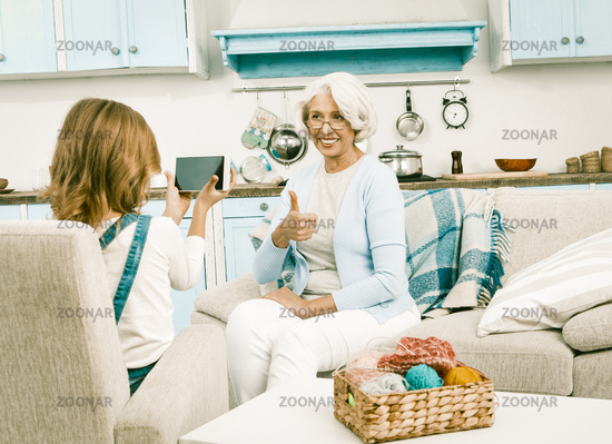 Granddaughter help her beautiful grandmother with videoblogging