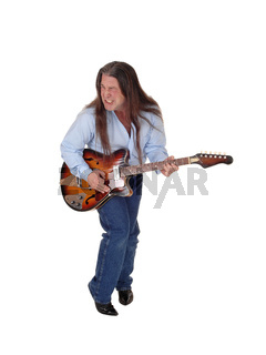 Man singing and playing the guitar in the studio