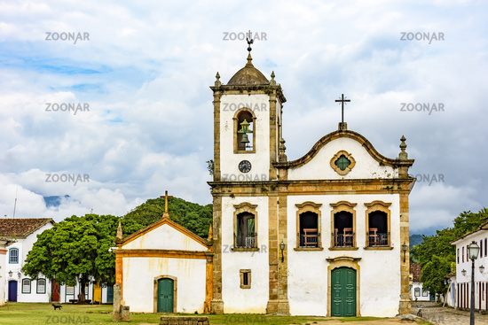 Old streets with historic church facade and houses in colonial architecture