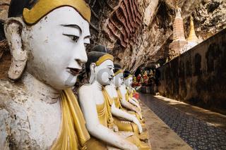 Buddha statues in a row in Kawgun cave near Hpa-an, Myanmar, Asia