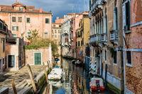 Venice, Italy - 03/18/2019 - small canal in the dorsoduro district