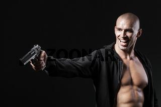 evil smiling man shooting gun isolated on black background