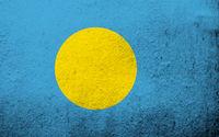 The Republic of Palau National flag. Grunge background