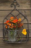 Flower arrangement with rosehips