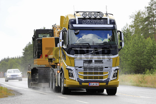 Wide Load Transport on Rainy Highway