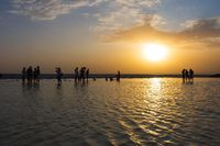 People in sunset at Danakil salt lake