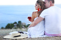 Lovely coupleby the sea drinking rose wine