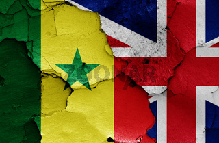 flags of Senegal and UK painted on cracked wall