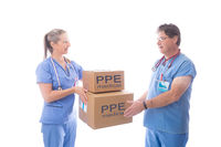 Doctors and nurses receiving a delivery of medical equipment PPE