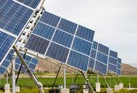 Solar energy Panels on a green field. Alternative energy, Energy from sun