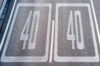 Forty Kilometers or Miles Per Hour Speed Limit Sign in Road Paint