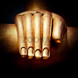Big golden Buddhas hand. Thailand