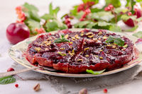 Traditional upside-down pie with plums.