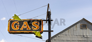 Old neaon sign with glass missing says GAS