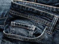 Texture of old used jeans using as background