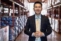 Asian businessman owner portrait in distribution warehouse
