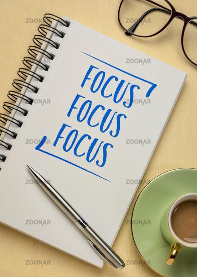 Focus - concept in a spiral notebook