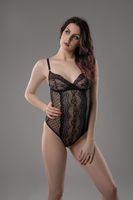 Young brunette in black silk body view