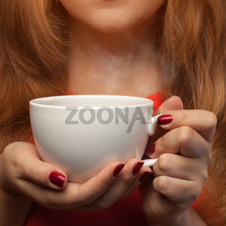 woman holding hot cup
