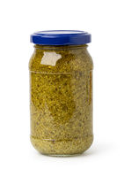 basil pesto sauce in glass jar