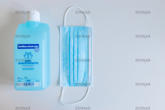 GERMANY - MARCH 22, 2020: Virus und Bacteria prevention equipment. Surgical Mask and hand sanitizer for hygiene against coronavirus pandemic.