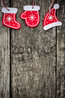 Red Christmas tree decorations on grunge wood