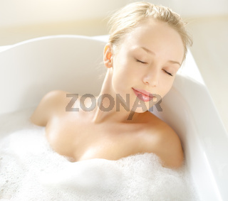 Attractive girl relaxing in bath
