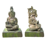 Ancient Mayan Statue, front and side view.