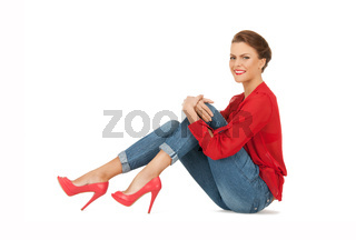 lovely woman in red blouse and jeans