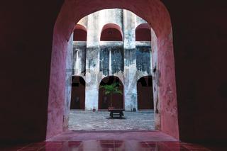 View through arch into patio in the former monestary Convent de San Bernardino de Siena in Valladolid, Yucatan, Mexico