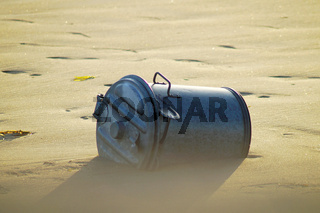 garbage bin in blurry Sandy beach. Protecting the environment by recycling and throwing away trash