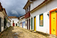 Old houses in colonial architecture and cobblestone streets