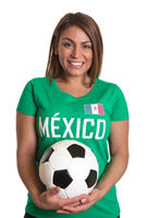 Laughing mexican girl with football