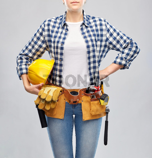 woman or builder with helmet and working tools