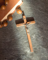 Vintage Franciscan rosary on stone background
