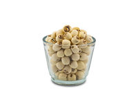 Dried Lotus seeds in a glass bowl on white background.