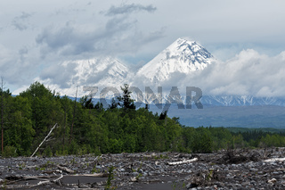 Klyuchevskoy Volcano and Kamen Volcano on cloudy day. Kamchatka Peninsula