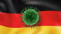 Model of Coronavirus on the background of German flag.