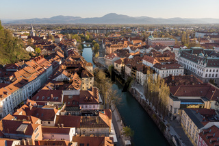 Aerial drone panoramic view of Ljubljana, capital of Slovenia in warm afternoon sun