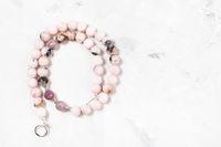 coiled necklace from cherry blossom rose quartz