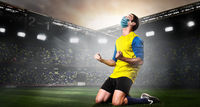 Soccer or football player in mask
