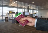 Concept of Covid-19 immune certificate and UK passport to show immunity to virus at airport