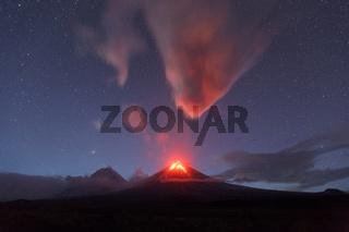 Night view of eruption active Klyuchevskaya Sopka or Klyuchevskoy Volcano on Kamchatka Peninsula
